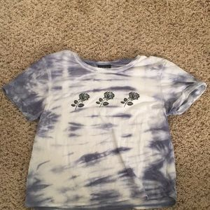 A blue and white crop - top from the brand Empyre.